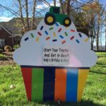 Rainbow cupcake with tractor topper